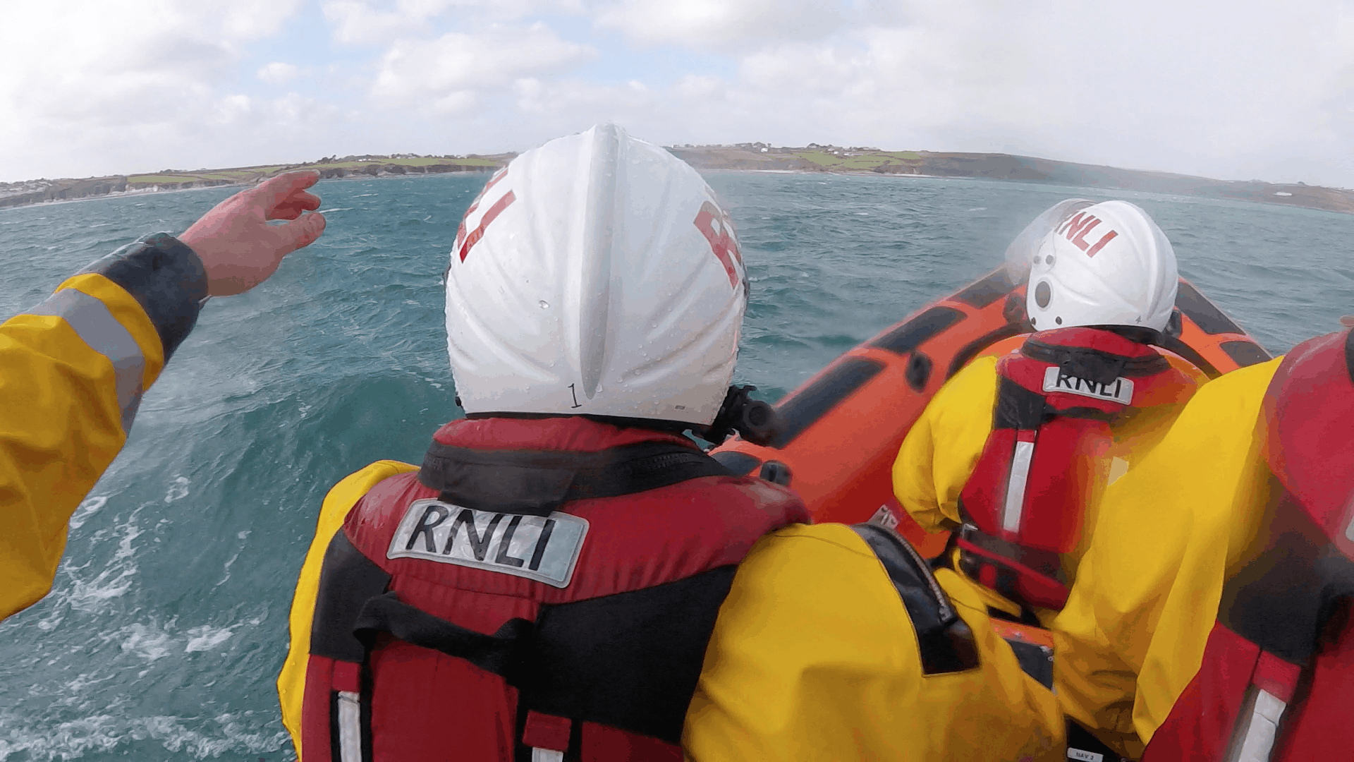 Image of inshore lifeboat and crew going to aid of kayaker