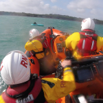 Inshore lifeboat crew going to aid of kayaker
