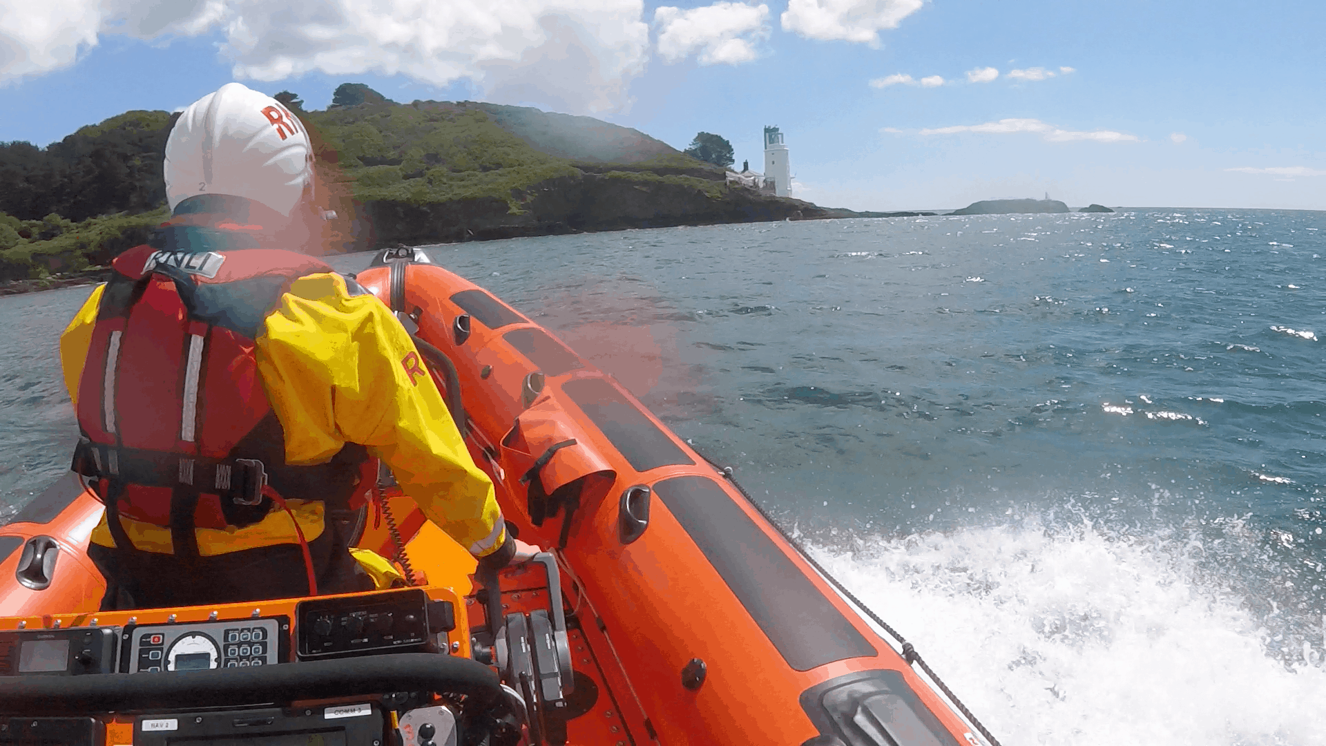 Inshore lifeboat approaching St Anthony Lighthouse